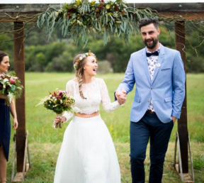 Dark 3 post timber arch with rustic florals