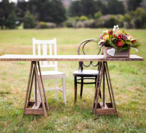 Rustic signing table with whimsical mismatch chairs