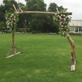 Rustic tree arch with antique roses
