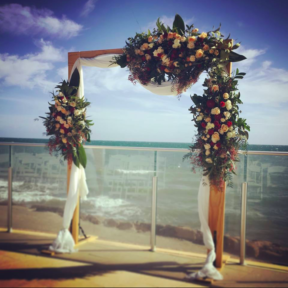 Blonde timber arch with deluxe florals